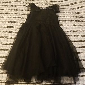 """Black """"Bat"""" Dress with Tooling on the skirt"""